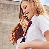 Girl wearing white cotton stain resistant M&S shirt