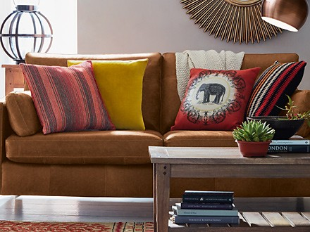 Hendrix leather sofa, Sanford wooden coffee table and cushions in living room