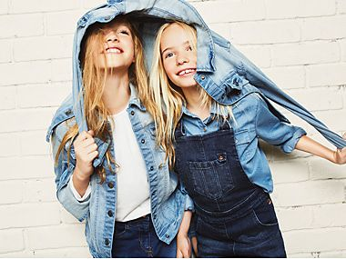 Two girls in denim jackets