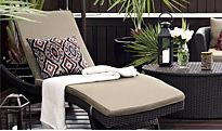 A sun lounger and patio furniture