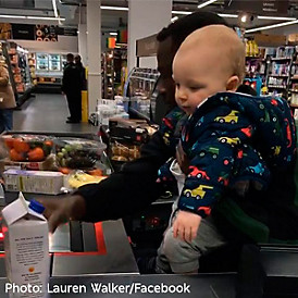 M&S customer assistant Mubarak Ahmad entertained a stressed mum's baby while she shopped