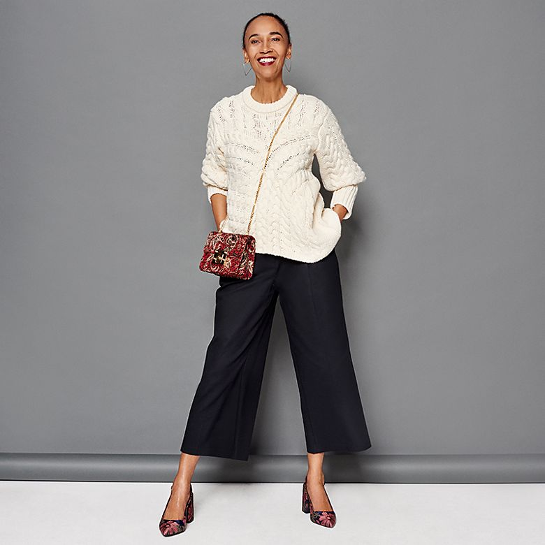 Stylist Mouchette Bell wears a cream cable-knit jumper
