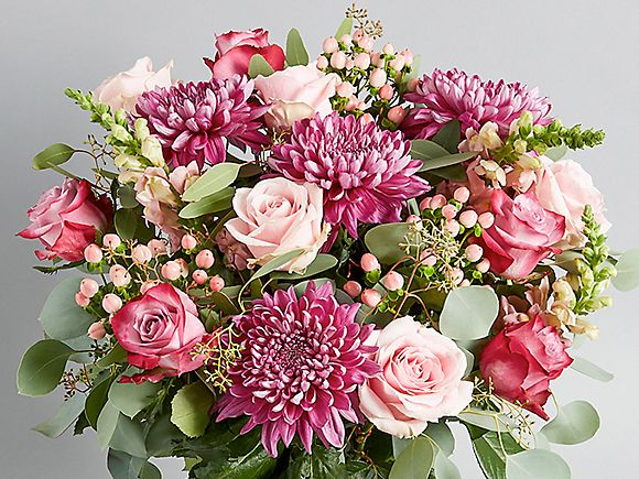A Collection bouquet with light and dark pink roses, buds and chrysanthemums