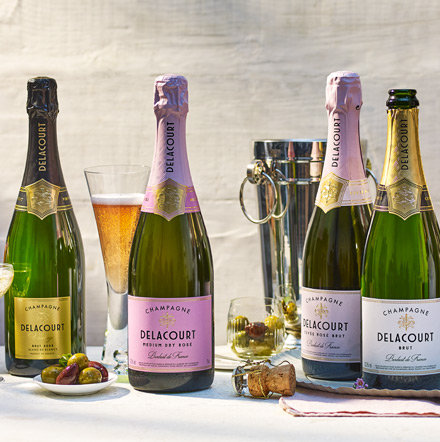 Delacourt champagne bottles with glasses