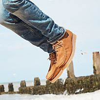 Boy jumping wearing sandy M&S shoes