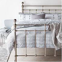 Castello metal bed with grey bedding