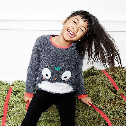 Girl wearing Christmas penguin jumper