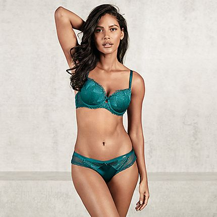 Woman in matching green bra and knickers