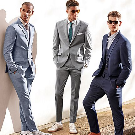 Three men wearing sharp prom suits ideal for a leavers ball or prom