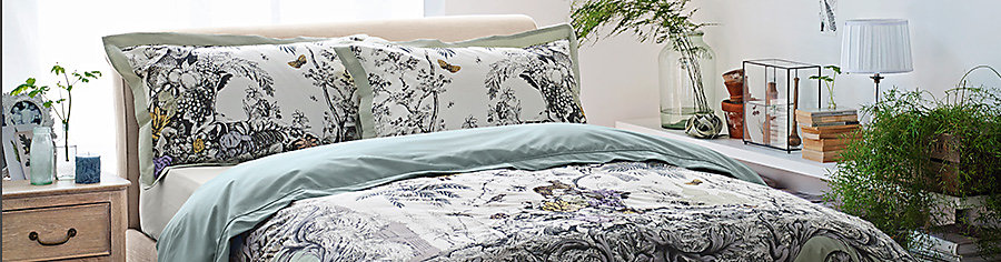 Botanical bedding and Naomi bedside table