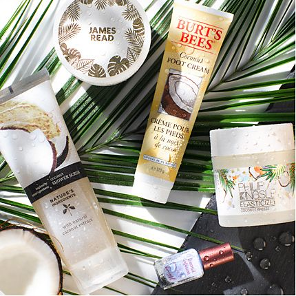 Coconut-themed beauty products in a tropical setting