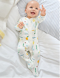Baby wearing sleepsuit
