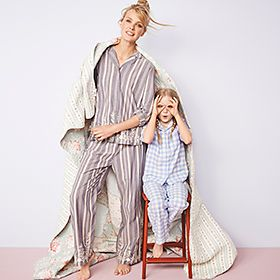 Mother and daughter in cotton pyjamas