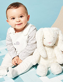 Baby with cuddly toys