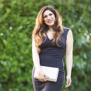 Blogger Vicki Psarias wearing black sleeveless dress