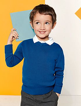 A boy wearing a blue school jumper