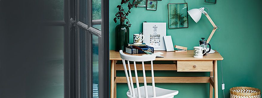 Home office furniture, including a wooden desk and chair