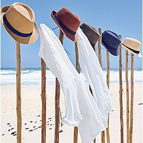 Linen shirts hanging up on a beach
