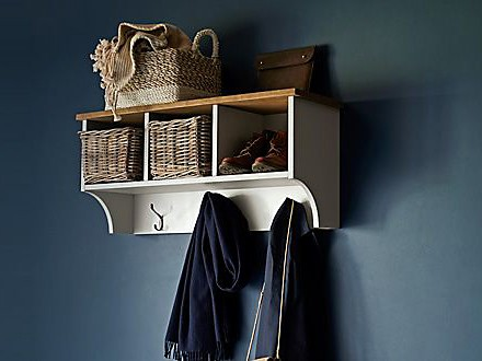 Hallway shelf unit on navy wall