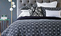 Stylish grey bed linens and cushions