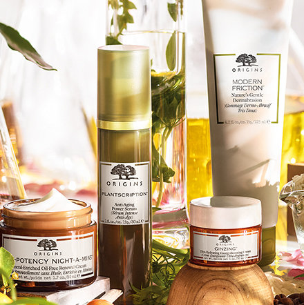 Origins skin care products surrounded by botanicals