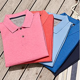 Various mens polo shirts laid on decking