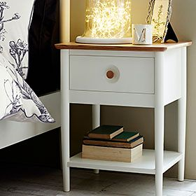 A painted wooden bedside table