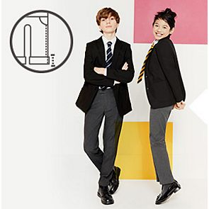 Boy and girl wearing school trousers