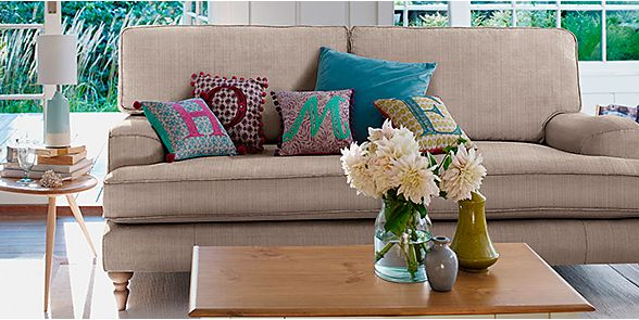 A sofa with cushions in a modern living room