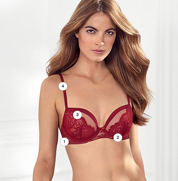 Model wearing red lace bra