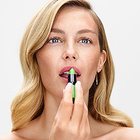 Woman applying Barry M's Genie Lip Paint