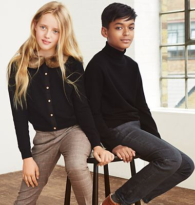 A boy and a girl wearing wool jumpers