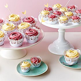 Pink and cream cupcakes on a white cake stand