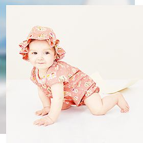 Baby in pink romper suit