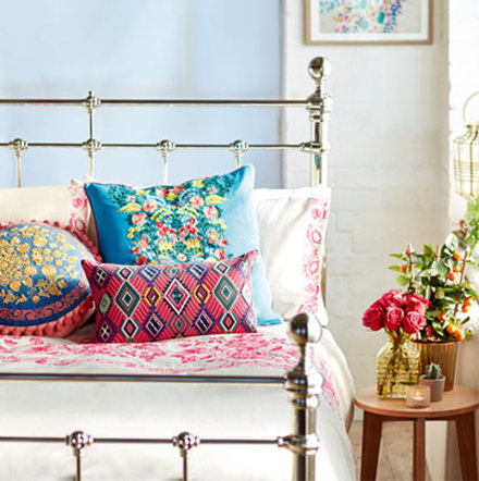 Patterned bedding and cushions on a bed