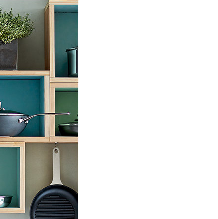 Shelving with pots and pans from the M&S cookware range