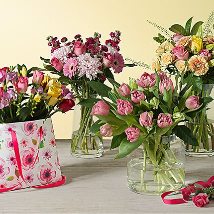Bunches of flowers in vases and flower bags