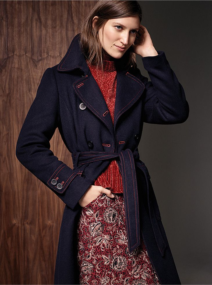 Model Wears Navy Trench Coat And Red Chenille Jumper