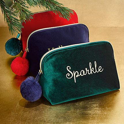 Velvet cosmetic bags on a festive gold background