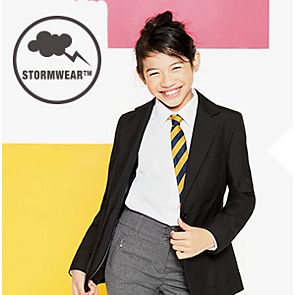 Girl wears black water-repellent school blazer