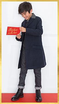 Boy wearing long coat and jeans