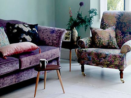 A sofa, armchair and side table in a living room