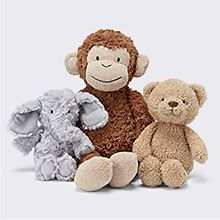 Monkey, elephant and bear cuddly toys