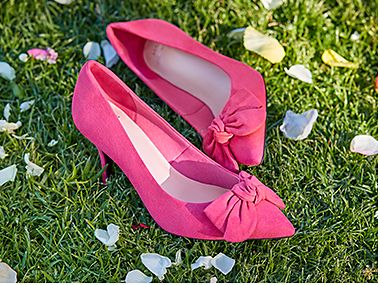 Pair of pink bow court shoes from the Curve collection