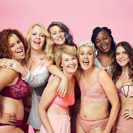Woman wearing pink bras for Breast Cancer Now campaign