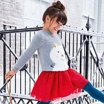 Girl wearing M&S Christmas jumper