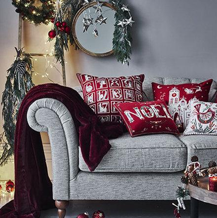 Christmas Cushions And Throw On Sofa
