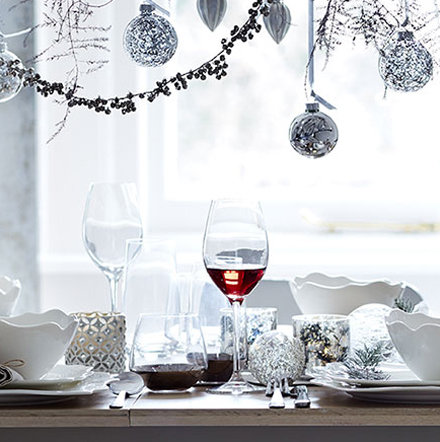 Christmas table setting with glassware and baubles