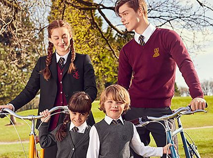 Kids wearing a selection of M&S uniform