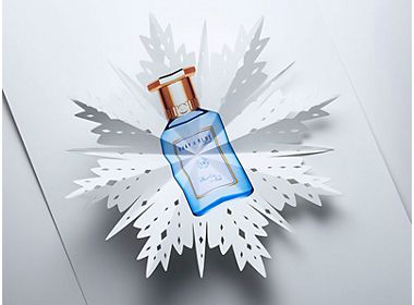 Paper cut-out of a perfume